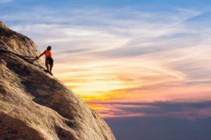 a climber climbing rocks
