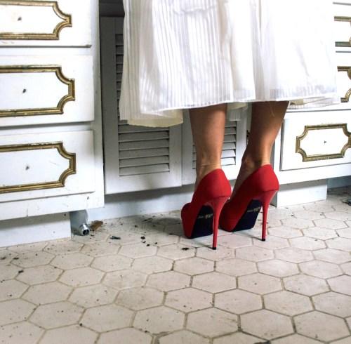 woman in red heel standing