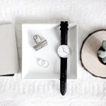 wrist watch, book and plant on desk