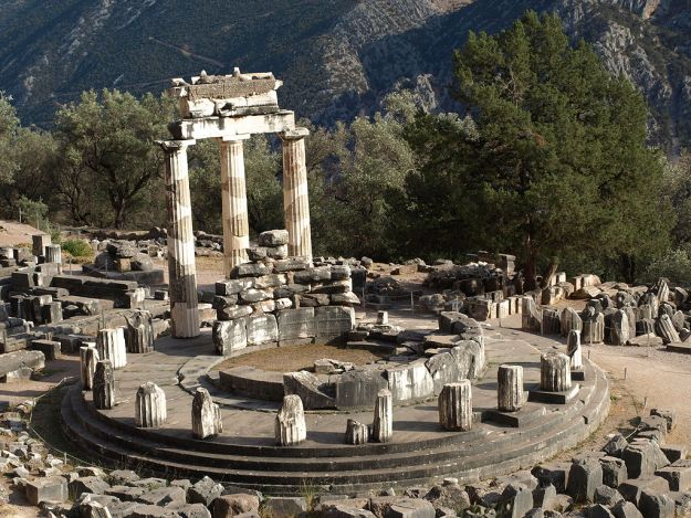 Ruins of the Tholos at Delphi via Wikimedia Commons