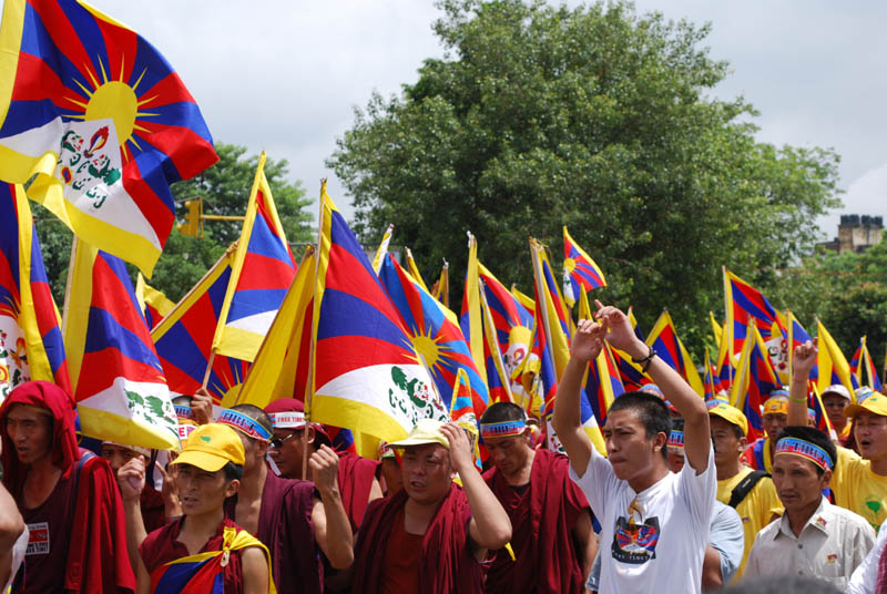 Tibetans in exile protest against Chinese rule over Tibet. Photo: TPI ...