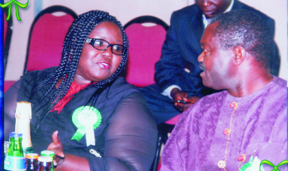Representative of the Governor of Rivers State and Commissioner for Information and Communication, Mrs Semenitari Ibim (left), explaining a point to chairman of the occasion, Senator, Dr, Ben Birabi, during the Buffet/Award Night to climax the Nigeria Union of Journalists, Rivers State Council, 2009 Press Week, at Hotel Presidential, Port Harcourt, last Friday.