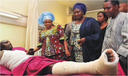 From left: First Lady, Dame Patience Jonathan, wife of the Senate President, Mrs Helen Mark; and Director, Clinical Services, National Hospital, Dr Obasi Ekunmakama, commiserating with a victim of the UN House bomb blast, during her visit to the hospital in Abuja , last Tuesday.