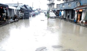 Flooded Alagba Street in Orile Iganmu community in Lagos, last Thursday. Photo: NAN