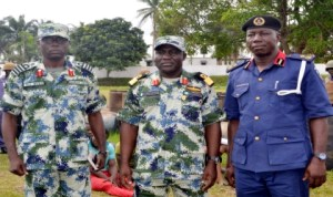 L-R:  Executive Officer, Nns Pathfinder, Capt. Sam  Bura,  Commander,  Commodore Godwin Ochai and  Deputy Commandant and Head of Operations, Nigeria Security and Civil Defence Corps (Nscdc),  Rivers State, Mr Olowoyotan Bamidele,  during  hand over of seven suspects and 250 drums  of illegally refined  diesel to Nscdc  in Port Harcourt, recently.