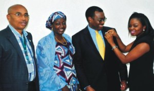 Minister of Agriculture and Rural Development, Dr Akinwumi Adesina (2nd right), being decorated with centenary Lapel Pin by the Field Executive, Centenary Lapel Pin Project, Miss  Kila  Abimbola in Abuja, yesterday. With them  are Minister of State,  Mrs Asabe Ahmed (2nd left) and Coordinator,  Centenary Lapel Pin Project, Mr Chuks Chilaka. Photo: NAN