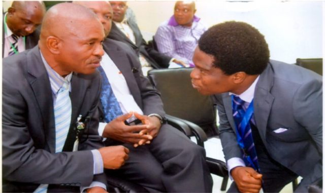 Acting Branch Controller CBN Mr. Emmanuel Etuk, (left), who represented Mr. Ndubisi Jude Ekioebelen Port Harcourt Branch Controller, chatting wth corporate communcation Manager, Mr. Obinali Okoli (rigt) during a workshop on financial inclusion CBN at Port Harcourt branch CBN, recently. Photo: Chris Monyanaga