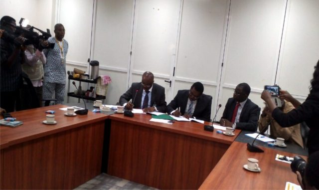 Officials of CB Geo-Solutions Sam Ezugworie and Chidiebere Offor signing the contract document of pre-sack migration of 3D seismic data acquisition with Shell while Bayo Ojulari and others watch. Photo: NAN