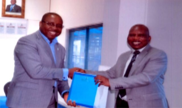Mr Noble Pepple (left), executive director, RSSDA exchanging a document with Prof Adeboyi Daramola, VC, Federal University of Technology, Akure, Ondo State between the RSSDA and the institute in Port Harcourt, recently. Photo: Ibioye Diama