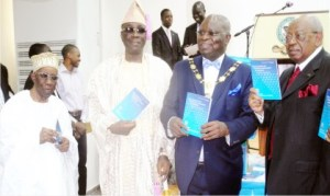"""L-R: Founder, Chartered Institute of Bankers of Nigeria, (CIBN), Alhaji Oladimeji Otiti, Oba of Lagos, Obarilwan Akiolu, President, CIBN, Dr Sina Aina and Chairman, First City Monument Bank, Otunba Micheal Balogun, during the unveiling of a book titled """"The Economy of Financial Inclusion In Nigeria"""" written by Dr Aina in Lagos."""