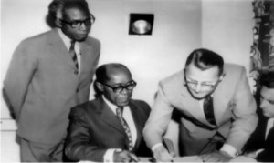 Pioneer General Manager, RSBC, Gabriel Okara (left), Pioneer Secretary to Rivers State Government, Pikibo Oju-Daniel Kalio (2nd left) and officials of a foreign firm contracted to install RSBC-TV, during the signing of agreement in 1973.