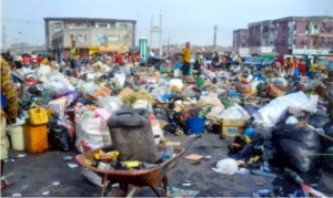 A refuse dump at the Ojoto/Azikiwe Road axis of Diobu in Port Harcourt, before the monthly environmental sanitation excercise on Saturday. The dump has bveen successfully evacuated. Photo: Chris Monyanaga