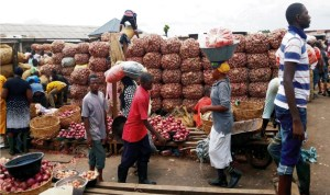 Bags of onions being offloaded at Mile 12 Market Lagos State after the reopening of the market.