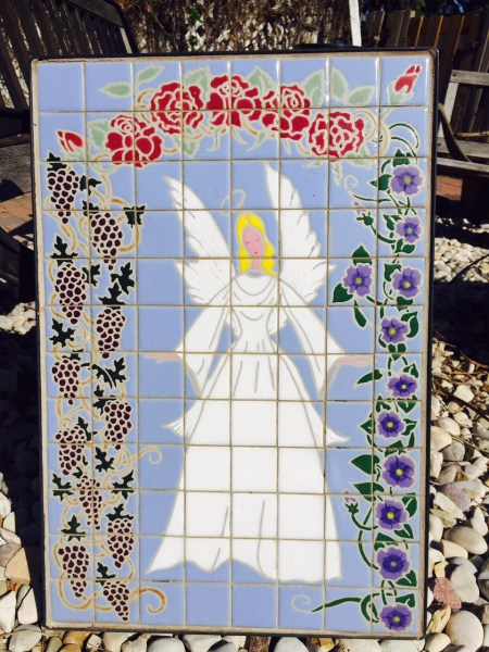 This angel mural will look beautiful in its new backyard home!
