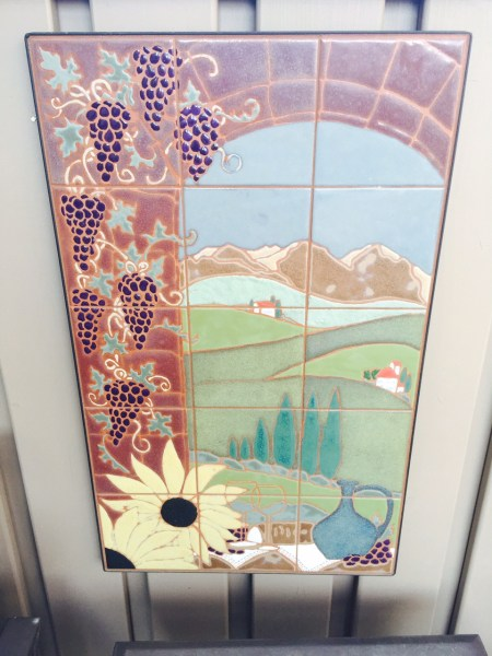 This Tuscany landscape mural has its new home in a customer's yard!