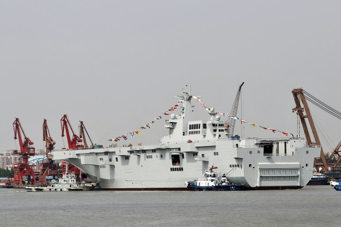 The Type 075 can carry helicopters, landing craft, hovercraft, tanks and drones