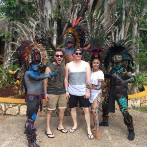 Posing with Mayan dancers. An organized day trip with the things to do in mexico riviera maya. riviera maya activities