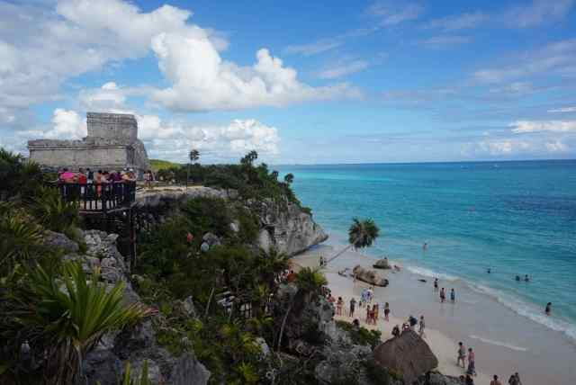 Tulum ruins on the cliff - one of the beautiful things to do in tulum mayan riviera. the beaches are part of the free things to do in riviera maya