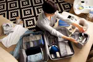 a woman packing her luggage