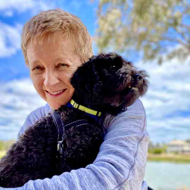 Kirsty, with a dog, provides travel tips for pet sitters. taking care of pets while traveling.