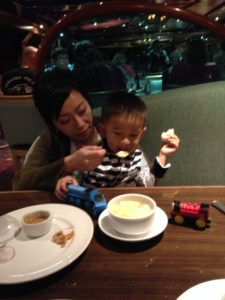 Tyler and Mom enjoying dinner in the dining room