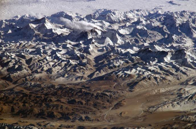 The Himalayas as seen from space looking south from over the Tibetan Plateau. Source: Wikipedia