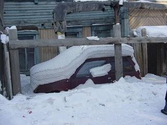 Car in Oymyakon under snow. Photo Credit: Natxo Rodriguez/Flickr