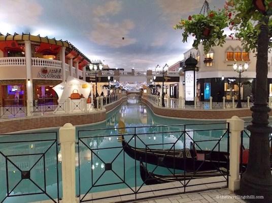 Venetian canal with gondola Villaggio Mall
