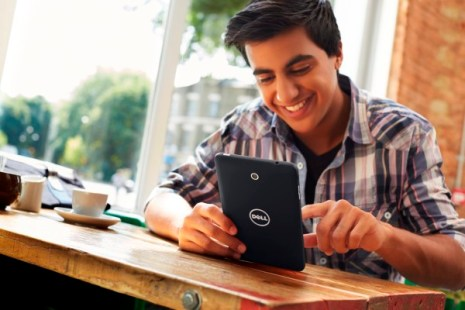 Young Man Using Venue 7 Tablet In A Cafe