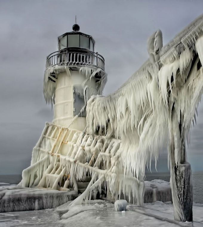 Frozen St. Joseph North Pier Lighthouse, Michigan, USA