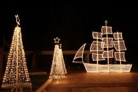 Christmas ship and trees at night