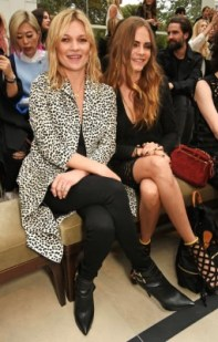 LONDON, ENGLAND - SEPTEMBER 21: Kate Moss (L) and Cara Delevingne attend the Burberry Womenswear Spring/Summer 2016 show during London Fashion Week at Kensington Gardens on September 21, 2015 in London, England. (Photo by David M. Benett/Dave Benett/Getty Images for Burberry) *** Local Caption *** Kate Moss;Cara Delevingne