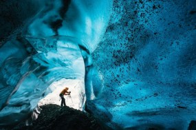 Wednesday 25th November 2015, Vatnajökull national park, Iceland: Photographer Mikael Buck with assistance from renowned local Icelandic guide Einar Runar Sigurdsson, explored the frozen world of Vatnajökull glacier in Iceland using Sony's world first back-illuminated full-frame sensor – which features in the ?7R II camera. His images were taken without use of a tripod or any image stitching techniques in photoshop. This was made possible through Sony's new sensor technology, allowing incredibly detailed low-light hand held photography. Previously images this detailed would have required carrying bulky equipment to the caves, some of which can require hiking and climbing over a glacier for up to two hours to to access. This picture: Inside the 'ABC cave' - which stands for Amazing Blue Cave. Guide Einar Runar Sigurdsson is seen taking a photo at the entrance to the cave PR Handout - editorial usage only. Photographer's details not to be removed from metadata or byline. For further information please contact Rochelle Collison at Hope & Glory PR on 020 7014 5306 or rochelle.collison@hopeandglorypr.com Copyright: © Mikael Buck / Sony 07828 201 042 / mikaelbuck@gmail.com