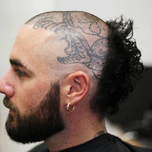 Scullet With Head Tattoo