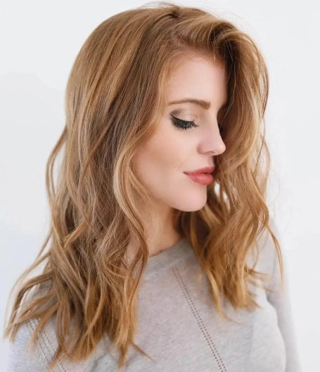 Wavy Coper Strawberry Blonde Hair With Highlights
