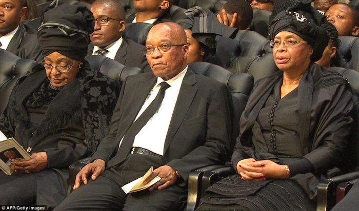 Sombre: South Africa's current president Jacob Zuma sitting between Winnie Mandela and Graca Machel