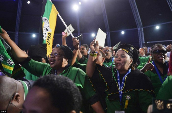 Support: African National Congress supporters chant before the start of the funeral