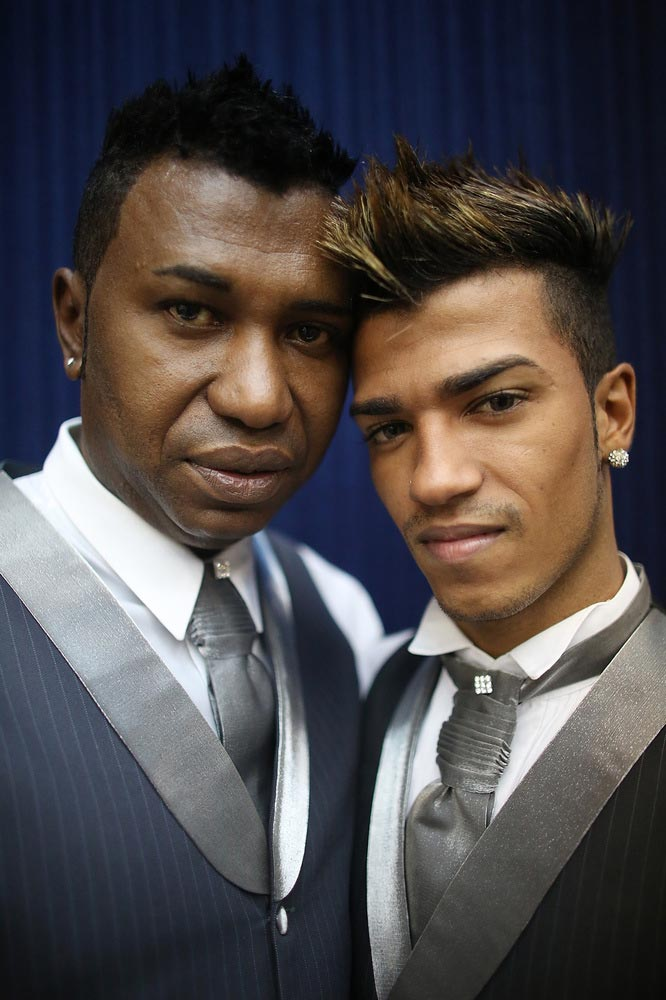 Couple Renato (L) and Ronald, together nine months, pose before marrying at what was billed as the world's largest communal gay wedding on December 8, 2013 in Rio de Janeiro, Brazil. 130 couples were married at the event which was held at the Court of Justice in downtown Rio. In May, Brazil became the third country in Latin America to effectively approve same-sex marriage via a court ruling, but a final law has yet to be passed. (Photo by Mario Tama/Getty Images)