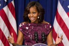 "In this July 10, 2013, file photo, first lady Michelle Obama speaks to mayors and other officials about the initiative, ""Let's Move! Cities, Towns and Counties,"" in the Eisenhower Executive Office Building on the White House complex in Washington. (Photo Credit: AP/Jacquelyn Martin)"