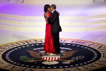 TOPSHOTS US President Barack Obama and First Lady Michelle Obama kiss while dancing at the Commander and Chief Ball at the Washington Convention Center January 21, 2013 in Washington, DC. Obama and Biden attended Inauguration balls after being ceremonially sworn in for a second term leading the United States earlier today. AFP PHOTO/Brendan SMIALOWSKIBRENDAN SMIALOWSKI/AFP/Getty Images ORG XMIT: 159824740