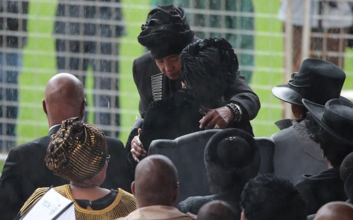 Winnie Mandela hugs Graca Mandela at one of the events celebrating the life of Nelson Mandela