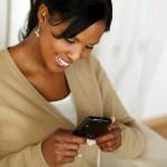 bedroom smartphone woman happy smiling phone
