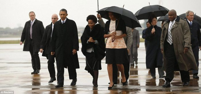 Former President George W. Bush and his wife Laura are seen coming off of Air Force One after the Obamas as the two couples shared the plane with former Secretary of State and first lady Hillary Clinton