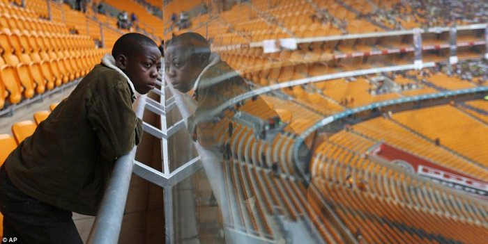 Inspiration: 14-year-old Thomas looks out across the arena as the crowds start to file in for the memorial service