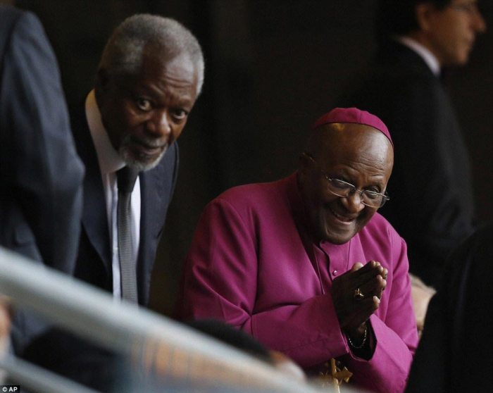 Jovial: Former UN Secretary-General Kofi Annan (left) and retired Anglican Archbishop Desmond Tutu appear in good spirits as they arrive for the service