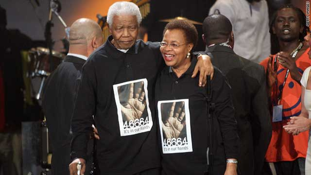 Mandela is joined by his wife Graca Machel-Mandela, whom he married in 1998, onstage during the 46664 concert in celebration of his life at Hyde Park on June 27, 2008 in London, England.