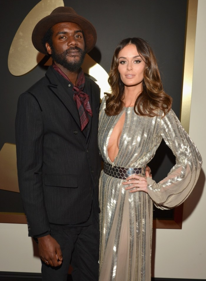 GRAMMY nominee Gary Clark Jr. and model Nicole Trunfio arrive at the 56th Annual GRAMMY Awards on Jan. 26 in Los Angeles (Photo Credit: Lester Cohen/WireImage.com)