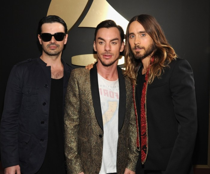 Tomo Milicevic, Shannon Leto and Jared Leto of Thirty Seconds To Mars arrive at the 56th Annual GRAMMY Awards on Jan. 26 in Los Angeles (Photo Credit: Kevin Mazur/WireImage.com)
