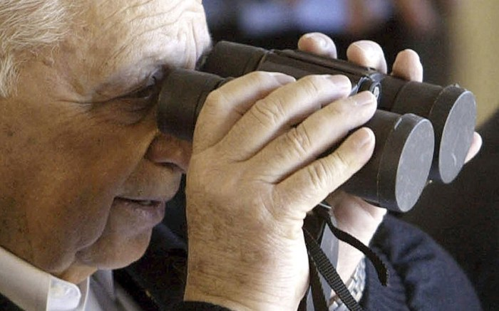Ariel Sharon looks through a pair of binoculars during a visit to a military camp near Tel Aviv in 2002 (Picture: REUTERS/Nir Elias)