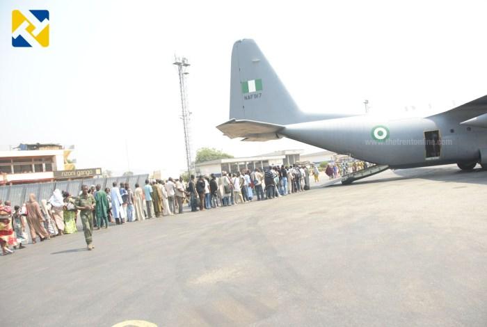Displaced Nigerians file into NAF C130 aircraft (Photo Credit: Defence Information)